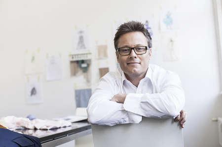 fulfill: Businessman smiling at desk LANG_EVOIMAGES