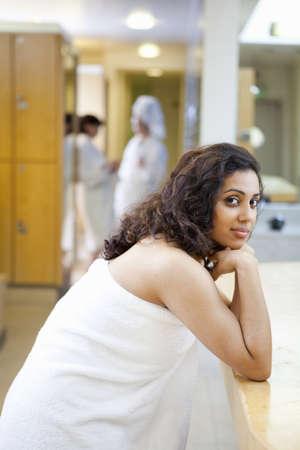 Woman wearing towel in locker room