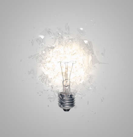 hardships: Close up of light bulb shattering LANG_EVOIMAGES