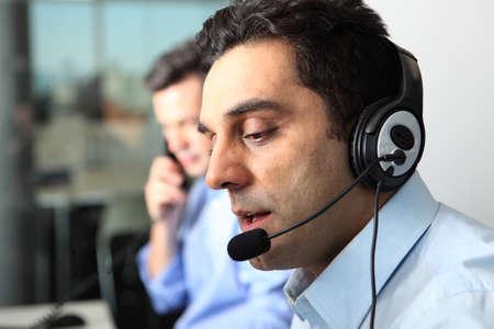 Businessman talking on headset LANG_EVOIMAGES