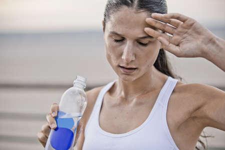 Runner wiping sweat outdoors