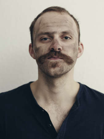 dirtied: Close up of man with mustache LANG_EVOIMAGES