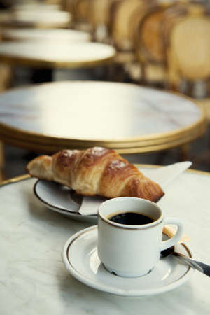 Pastry and cup of coffee on table