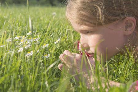 musing: Girl laying in grassy field