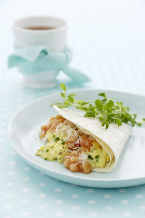 Plate of breakfast burrito with parsley