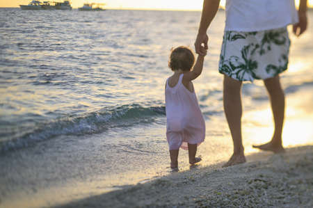dry tortugas: Father and toddler daughter on beach