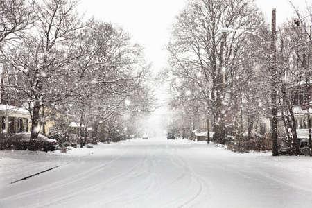 abodes: Snow falling on suburban street