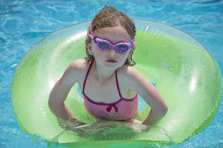 whimsy: Girl playing in swimming pool LANG_EVOIMAGES
