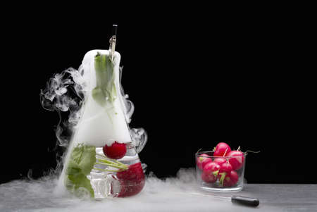 alteration: Tomatoes with fruit in smoking beaker LANG_EVOIMAGES