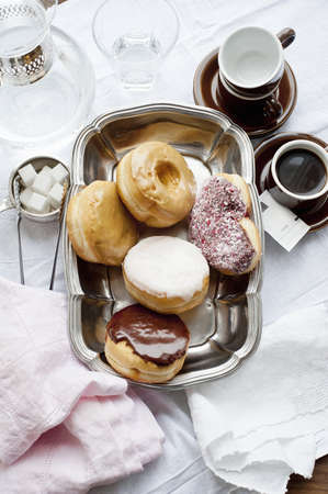 Tray of donuts with coffee and sugar LANG_EVOIMAGES