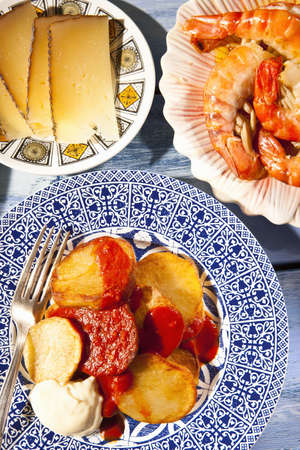 Plates of cheese,prawns and potatoes