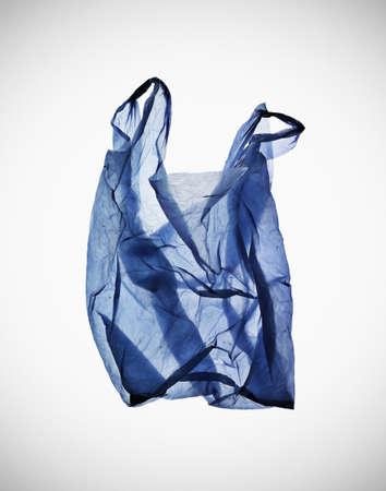 Crumpled blue plastic bag on table