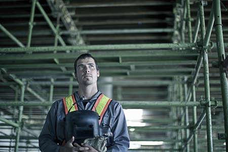 Construction worker with welding helmet