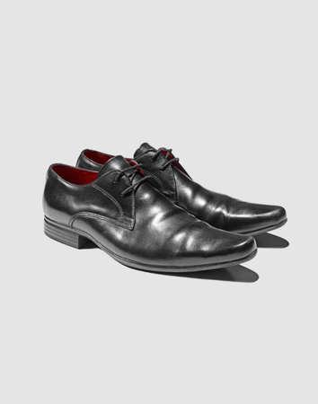 cutouts: Close up of mans dress shoes LANG_EVOIMAGES