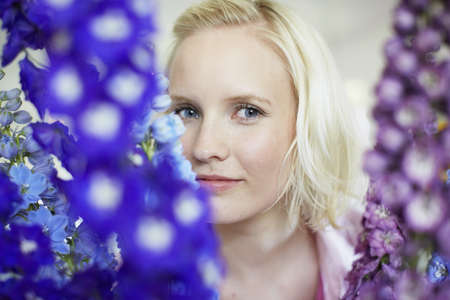 purples: Close up of woman with tall flowers