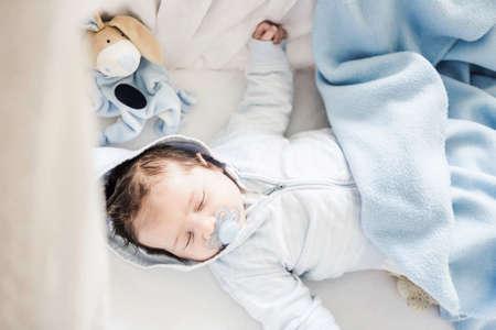 babys dummies: Baby boy sleeping on cot