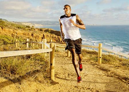 afroamerican: Man running on dirt path