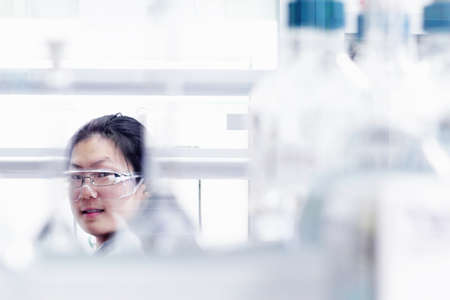Scientist wearing goggles over glasses