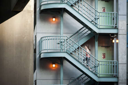 ascends: Woman running on apartment steps