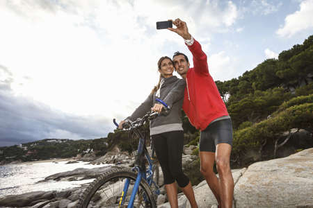 adventuresome: Couple taking picture on boulder