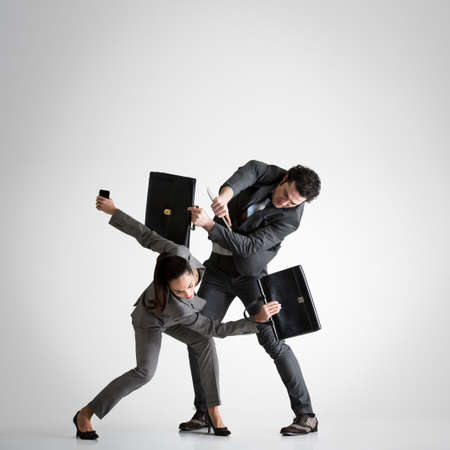 confrontational: Business couple fighting
