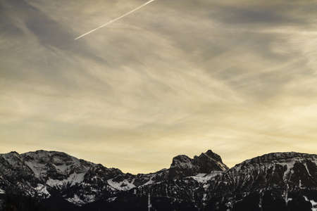Colorful sky over snowy mountains LANG_EVOIMAGES