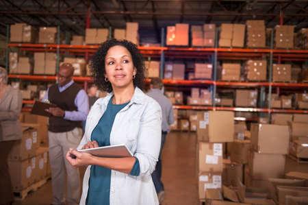 stocktaking: Female warehouse worker using digital tablet