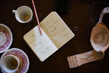 writing utensil: Open diary with wedding ring