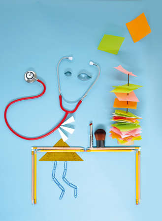 Stethoscope and stationery arranged against blue background LANG_EVOIMAGES