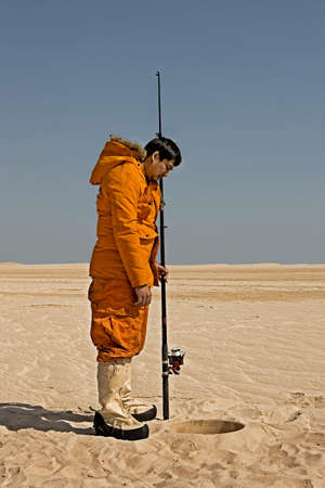 Eskimo fishing in desert
