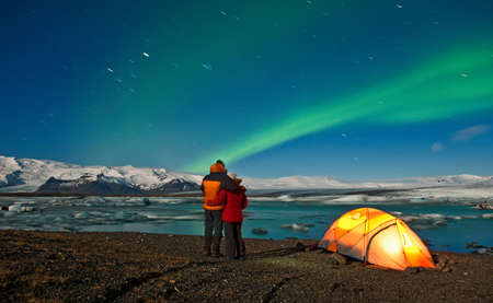 northern light: Mature couple standing by tent watching the Northern lights,Jokulsa Loni,Iceland LANG_EVOIMAGES