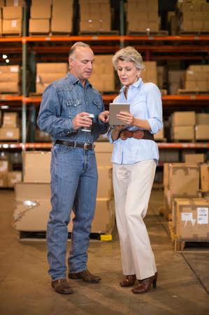 stocktaking: Warehouse workers using digital tablet