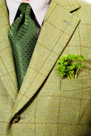 out of context: Green checked suit jacket with parsley in pocket