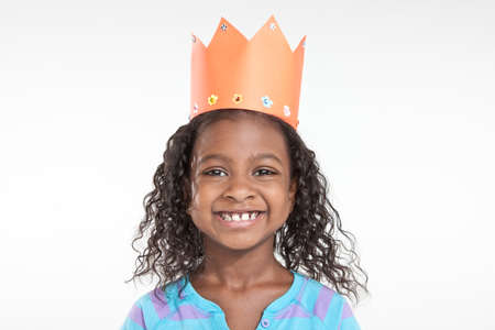 Girl wearing orange paper crown