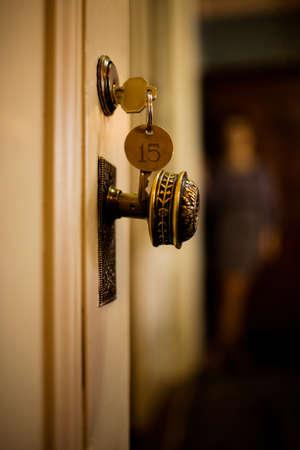 Keys in hotel room door LANG_EVOIMAGES