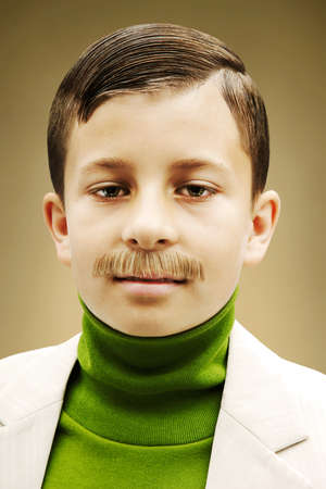top 7: Young boy dressed in beige suit with fake mustache