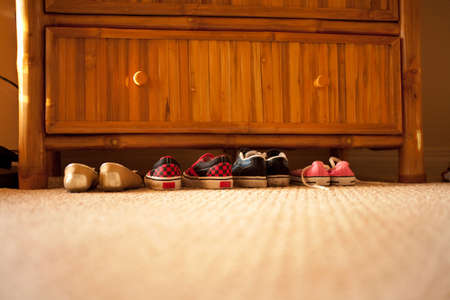 floor covering: Pairs of shoes under chest of drawers LANG_EVOIMAGES