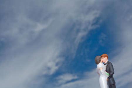 female likeness: Bride and groom figurine