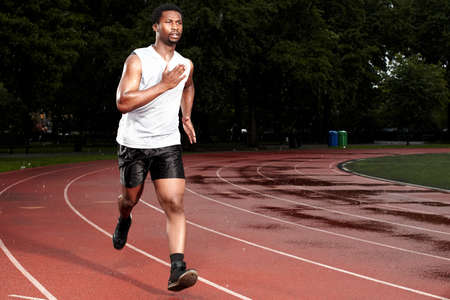 athletic wear: Young man sprinting on track