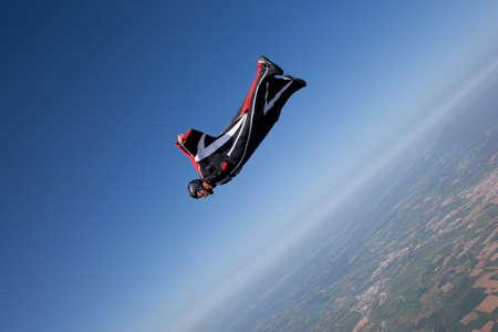 southern european descent: Man wingsuit flying LANG_EVOIMAGES