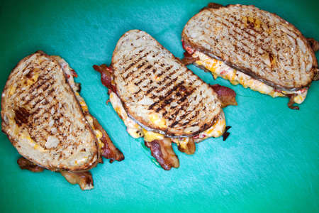 revulsion: Three grilled cheese sandwiches LANG_EVOIMAGES