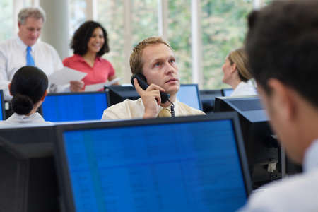 Office worker using telephone in office LANG_EVOIMAGES