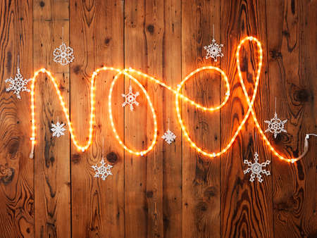 wood panelled: Christmas lights spelling Noel against wood panelling