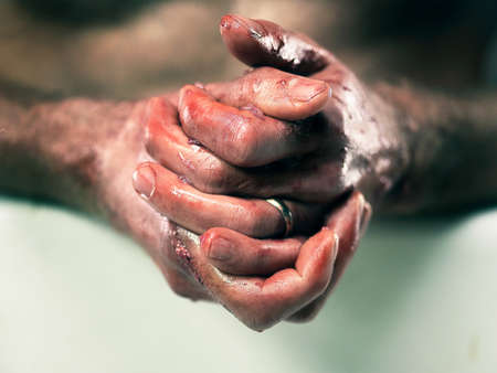 fishmonger: Fishmonger washing bloodied hands