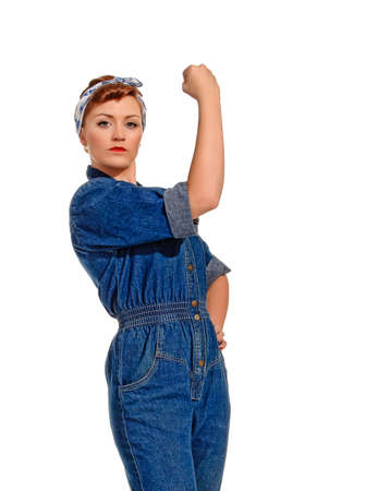 boiler suit: Retro-styled young woman flexing muscle