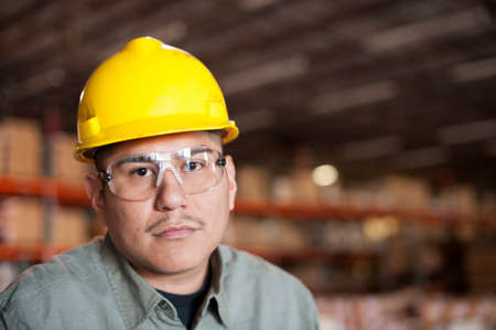 gifted: Portrait of mid adult man wearing hard hat and goggles LANG_EVOIMAGES