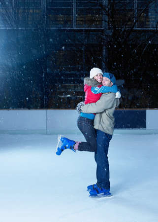 Couple embracing on an ice rink