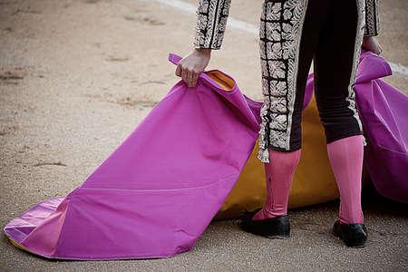 las ventas: Bullfighter holding pink cape,Las Ventas bullring,Madrid LANG_EVOIMAGES
