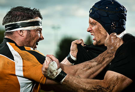 Rugby players grappling with each other