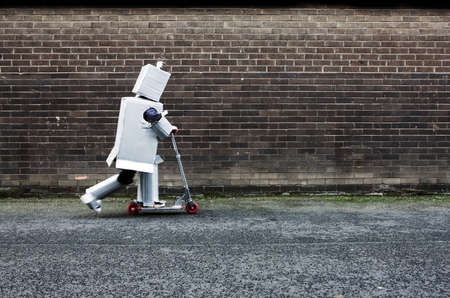 sayings: Boy dressed as robot riding scooter LANG_EVOIMAGES
